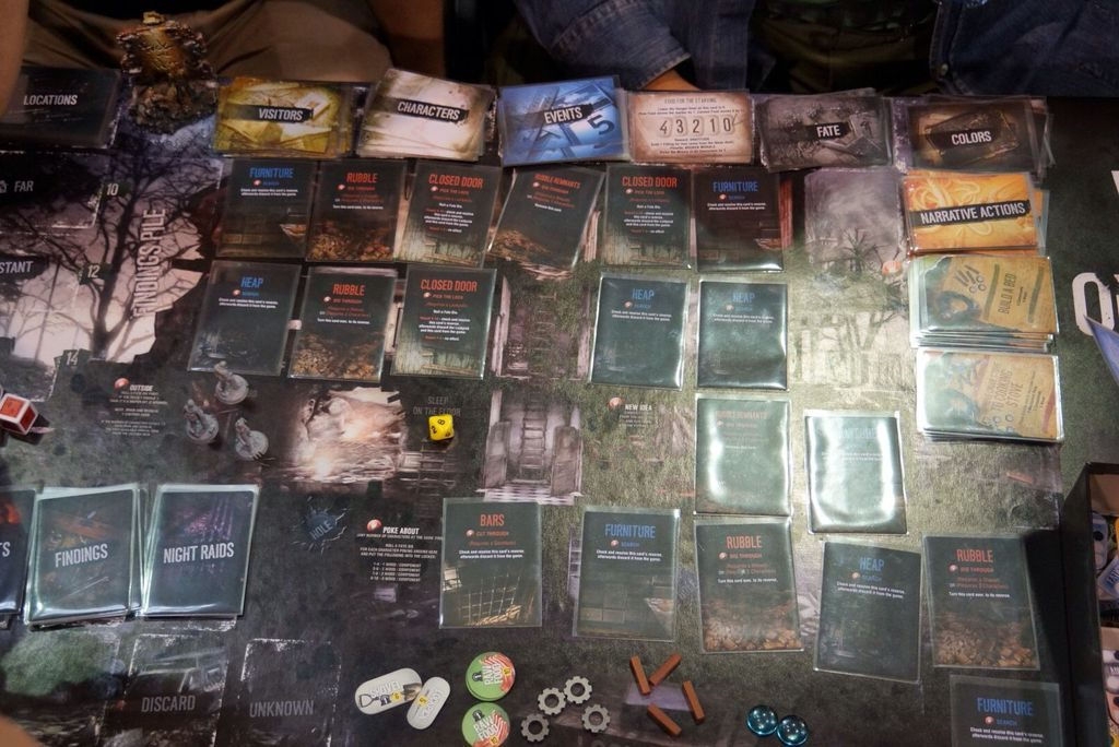 An example of This War of Mine: The Board Game board set-up